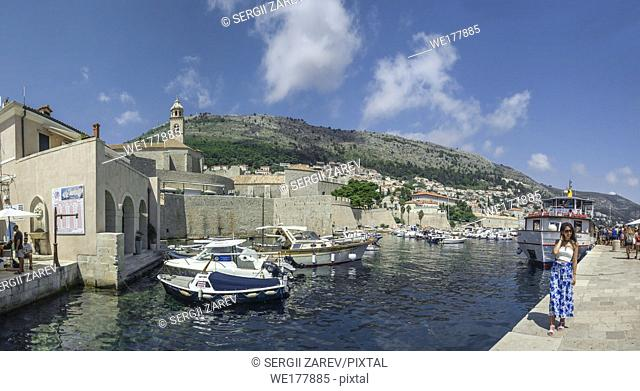 Dubrovnik, Croatia - 07. 13. 2018. Panoramic view of the Old Town and Old Port of Dubrovnik, Croatia, in a sunny summer day