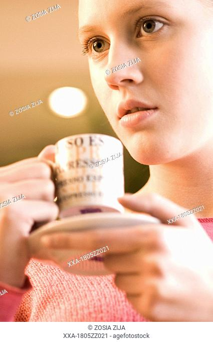 young woman drinking espresso