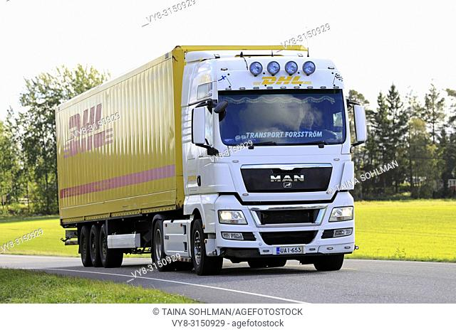 SALO, FINLAND - SEPTEMBER 23, 2018: White MAN TGX 18. 480 truck of Transport Forsstrom hauls DHL trailer along highway on a day of autumn