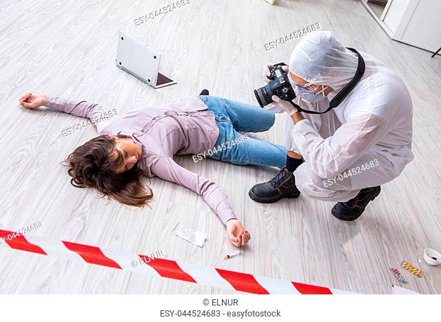 Forensic investigator at the crime scene investigating woman murder