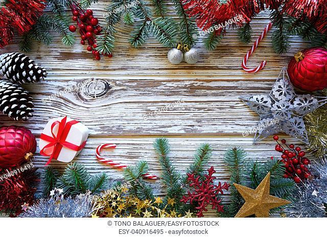 Christmas border frame on white wooden background