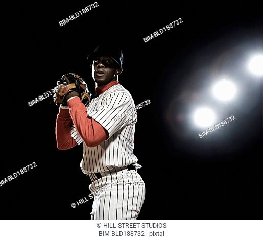 African baseball player pitching