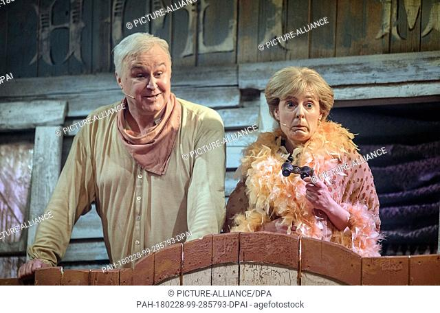 Christoph Zrenner as Horst Seehofer (L) and Antonia von Romatowski as Angela Merkel onstage during the musical comedy of the traditional...