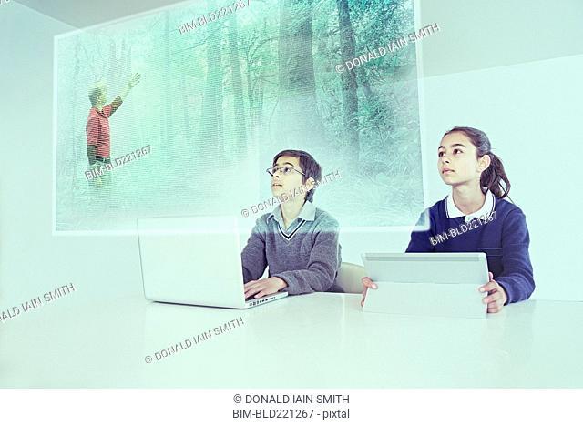 Children watching floating screen in online class