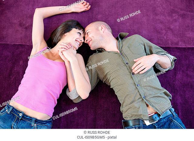 Couple lying on carpet