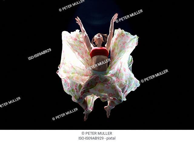 Dancer in midair wearing tutu