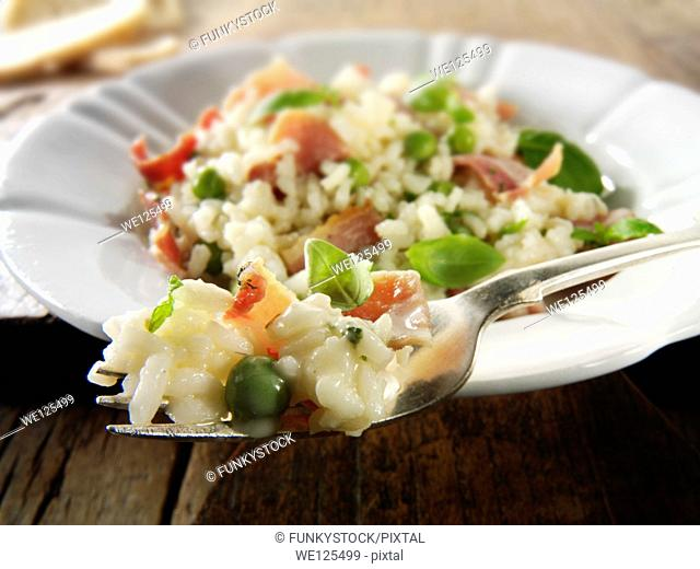 Classic risotto with fresh peas, bacon and mint
