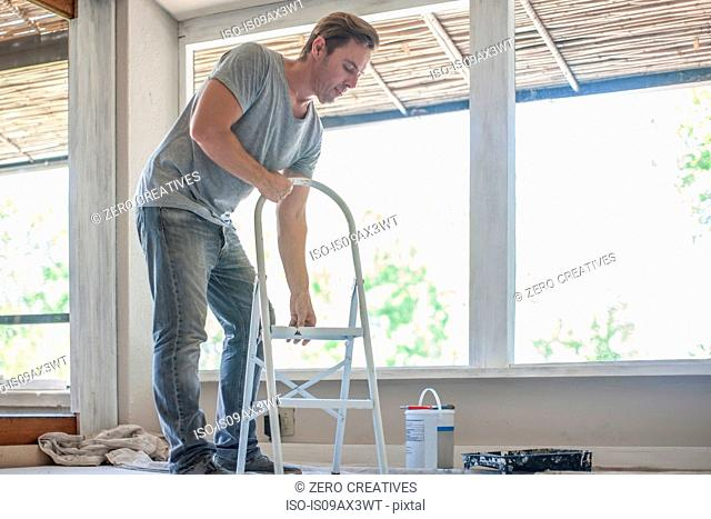 Builder adjusting ladder