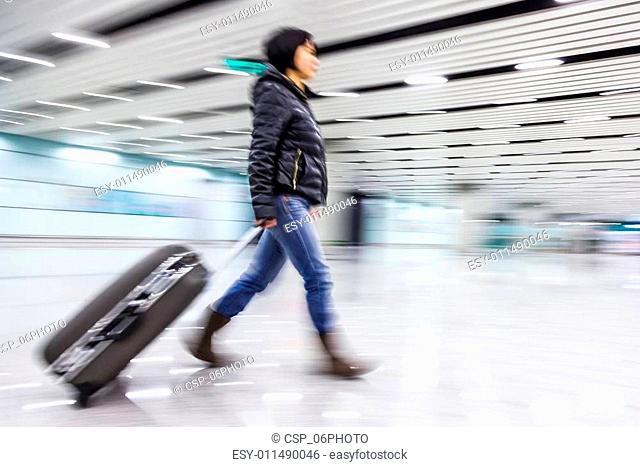 Passenger in the Beijing airport,motion blur