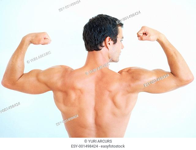 Rear view of handsome man flexing biceps on white background