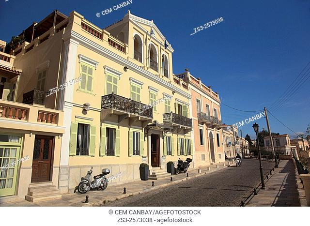 Motorcyclist in front of the Venice-style waterfront houses, Ermoupolis, Syros, Cyclades Islands, Greek Islands, Greece, Europe