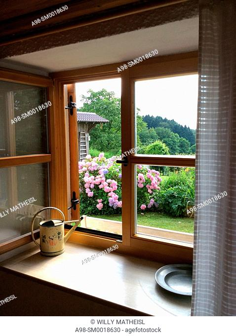 looking out of an old traditional Bavarian farmhouse room, Lower Bavaria, Germany, Europe