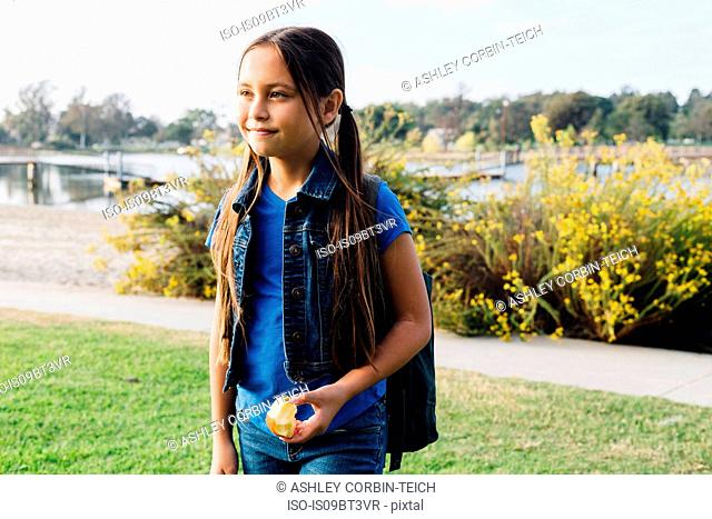 Girl enjoying apple, Long Beach, California, US