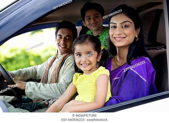 Portrait of a family inside a car