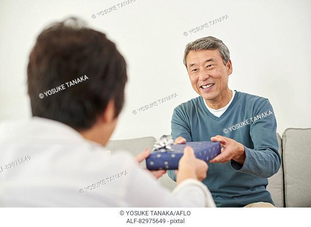 Japanese senior couple exchanging gifts