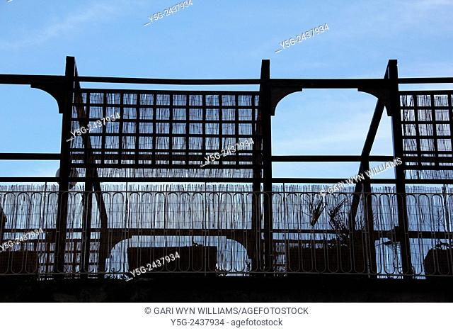 Silhouette of garden terrace balcony with wooden fence and roof structure in Rome, Italy