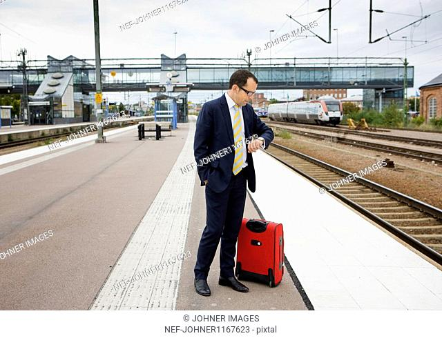 Businessman waiting for train