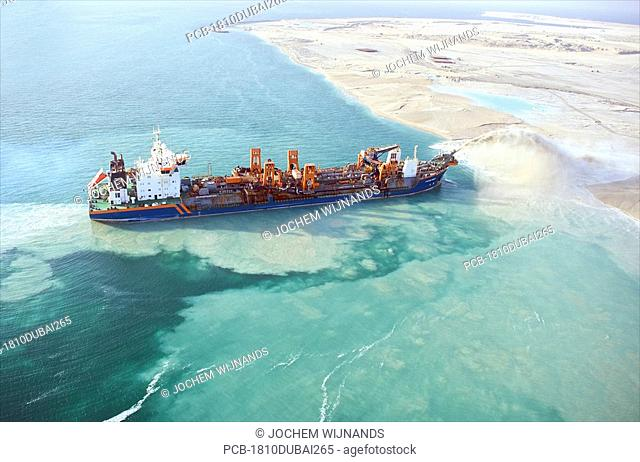 Dubai, the World, a dredge ship reclaiming land for the new harbour
