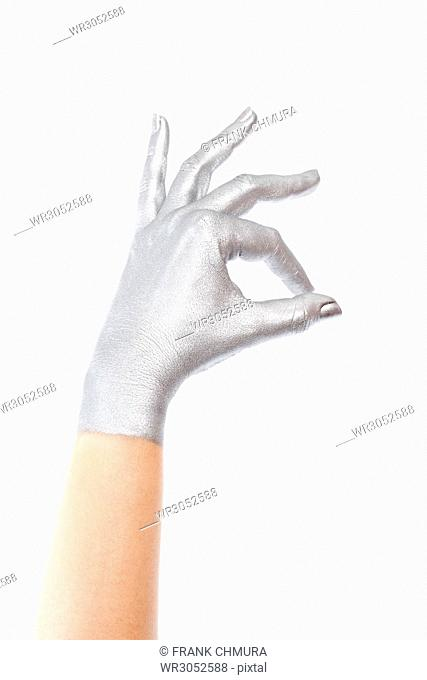 Hand with Silver Colour on Making Gestures