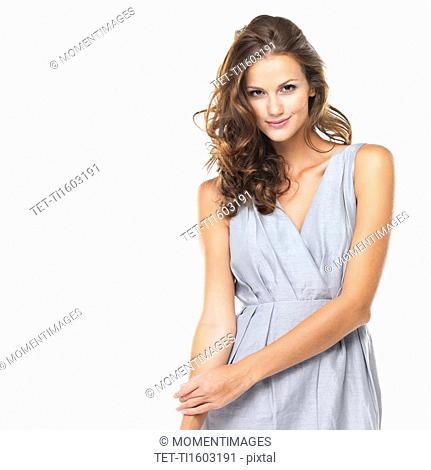 Studio portrait of young beautiful woman smiling