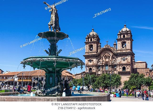 Jesuit Church and the Pachacuti fountain in the Plaza de Armas, Cusco, Peru