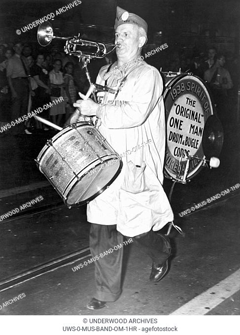 Los Angeles, California, September 19, 1938. American Legion member Jerry Havelka of Waukegan, Illinois and his one man band at the Legion convention parade in...