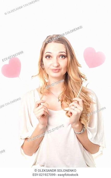 Girl fun posing with two hearts in studio