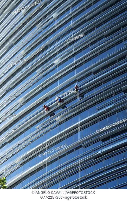 Window cleaners on an Abu Dhabi modern building in downtown, UAE