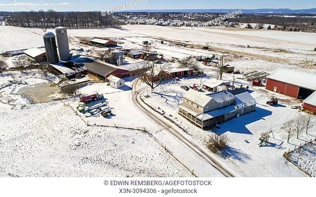 Aerial view of working dairy farm on a snowy day Taneytown, Maryland