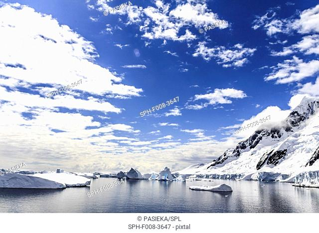 Antarctic coast. Mountains rising above the shores of the entrance of the Lemaire Channel of the Antarctic Peninsula