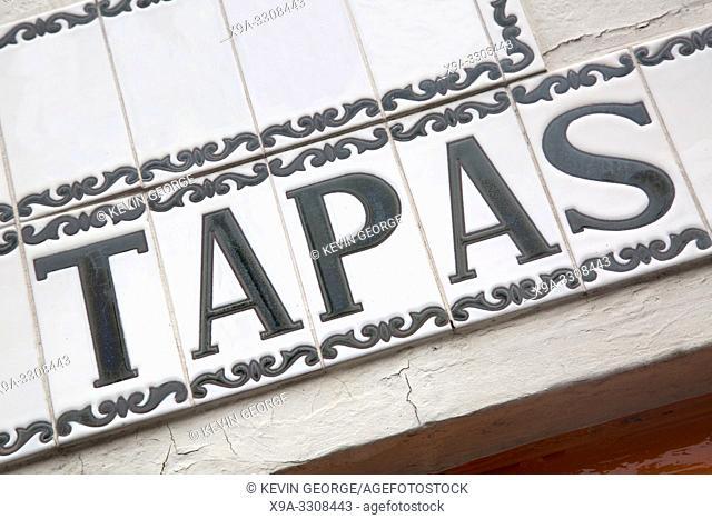 Tapas Sign on Building Facade with Diagonal Slant