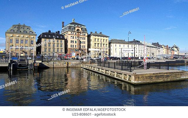 Skeppsbron quay in Stockholm, Sweden. The old town in the background