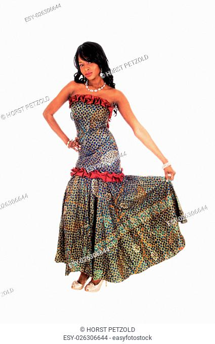 A beautiful African American woman standing in an African long dress.and black hair, isolated for white background.