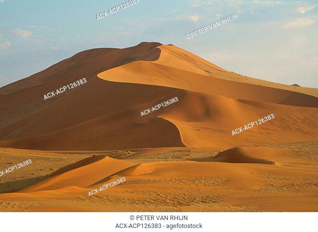 Magnificent red dunes of Sossusvlei National Park. Sossusvlei is a salt and clay pan formed from deposits from the Tsauchab River before its flow was blocked by...