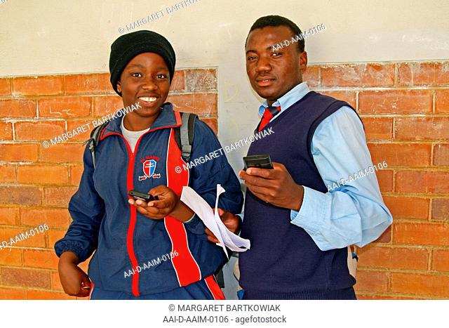 School children on their cellphones, St Mark's School, Mbabane, Hhohho, Kingdom of Swaziland
