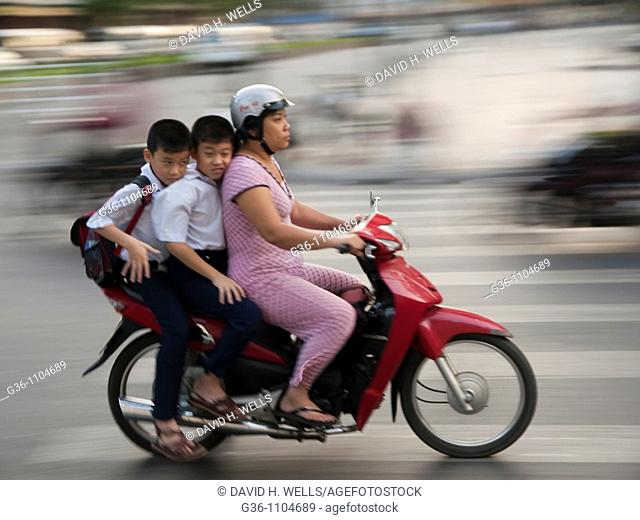 Travellers on two wheelers in Ho Chi Minh City, Vietnam