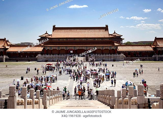 Beijing, China-August 5, 2010: Despite the strong heat in Beijing in August, thousands of tourists visit the Forbidden City each day