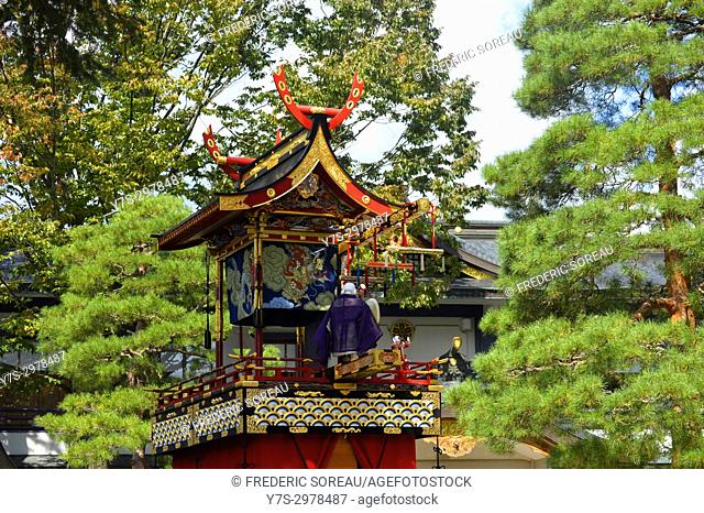 A mechanical marionette or puppet sits an ornate traditional wooden float during the Takayama festival in Japan,Asia
