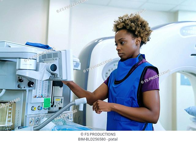 Black hospital technician wearing protective vest