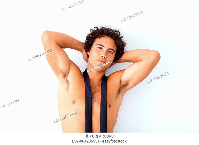 Handsome young hunk posing while isolated on white