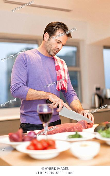 Man cooking dinner in kitchen