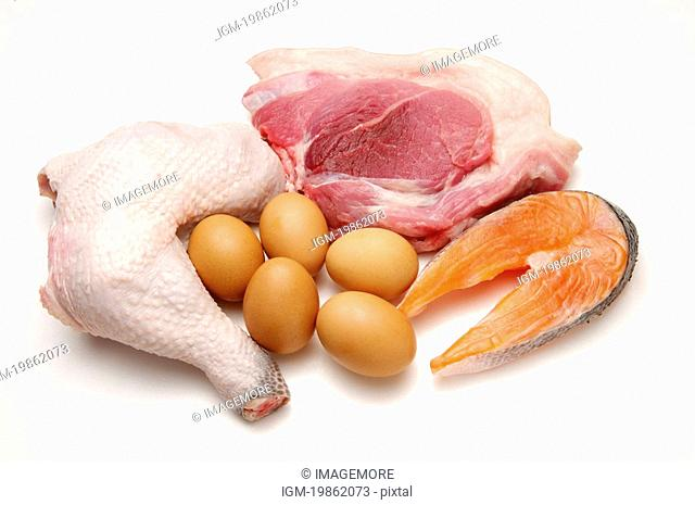 Close-up of chicken, pork, fish and eggs