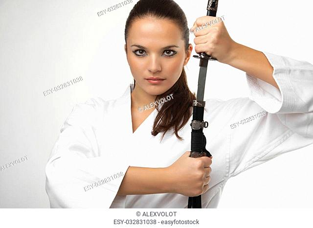 Attractive young sexy women with samurai sword on white background