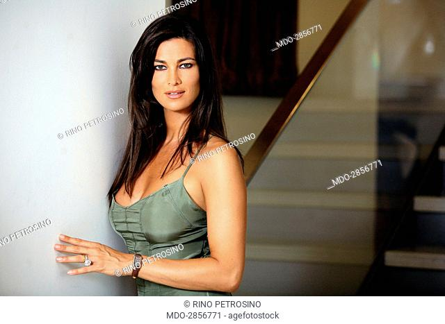 Italian actress Manuela Arcuri posing in a silk dress for a photo shooting beside a staircase. (She wears clothes by Richmond). Italy, 22nd April 2008