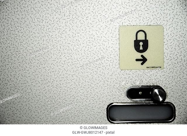 Close-up of an airplane lavatory lock and symbol
