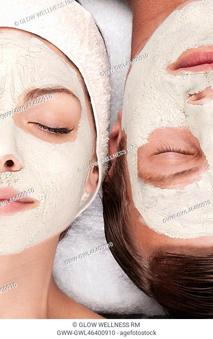 Couple with face pack on their faces