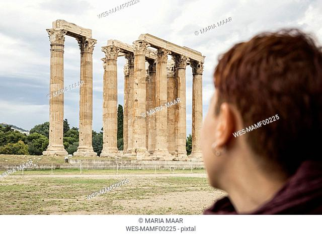 Greece, Athens, Olympeion, Woman looking at Temple of Zeus