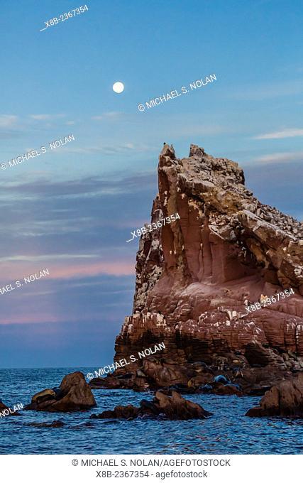 Full moon rising at sunset at Los Islotes, The Islets, Baja California Sur, Mexico