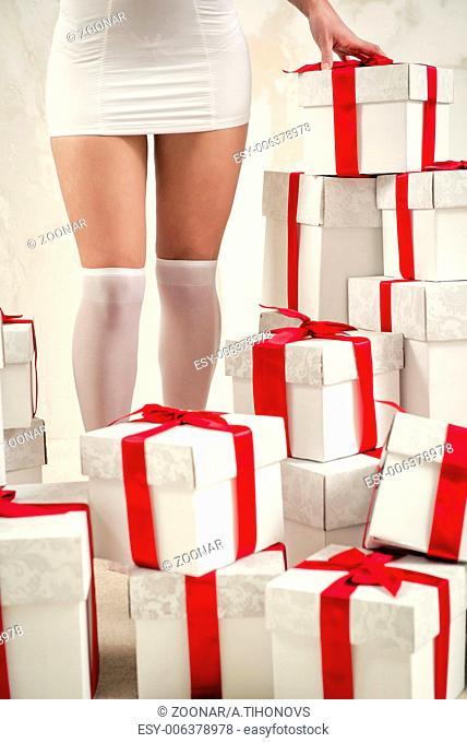 Woman's legs and heap of gift boxes