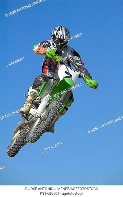 Enduro motorcyclist jumping